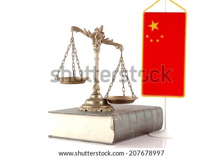 Decorative Scales of Justice on the book with Chinese flag on white. Law and order concept
