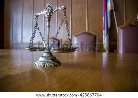 Decorative Scales of Justice on the table. Focus on the scales - stock photo