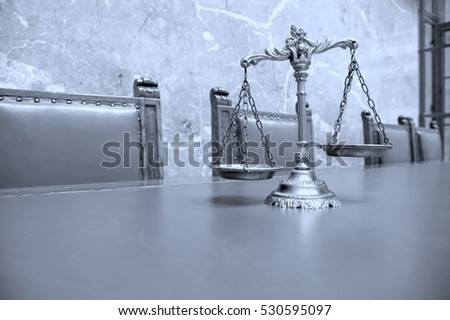 Decorative Scales of Justice on the table in courtroom, BLUE TONE