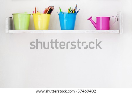 Decorative shelf on white wall as detail of kid interior - stock photo
