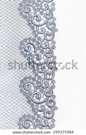 Decorative silver lace on insolated white background - stock photo