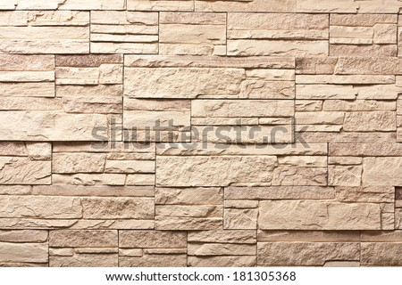 Decorative slate beige stone wall pattern, background. - stock photo