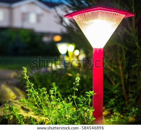 Decorative Small Red Solar Garden Lantern. Solar Powered Lamp