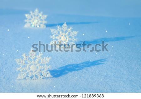 Decorative snowflakes on snow - stock photo