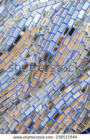 Decorative stained old glass pattern design on wall - stock photo