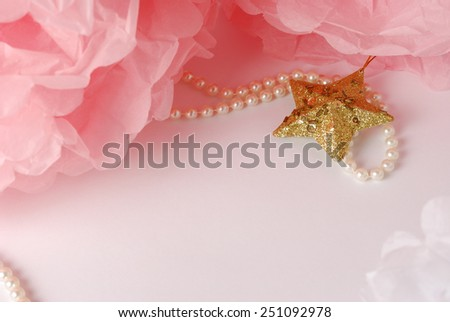 Decorative star, pearl beads and pink and white pom pom.Greeting or invitation card with copyspace - stock photo