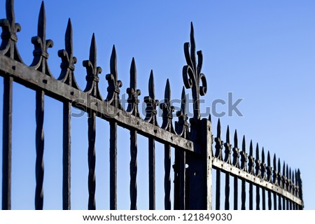 Decorative Steel Gate against blue sky - stock photo