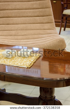 decorative table with armchair - stock photo
