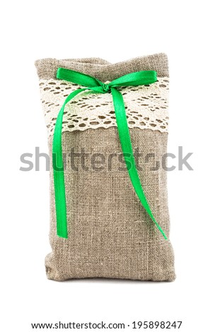 Decorative textile sachet pouch with a ribbon and bow on white background