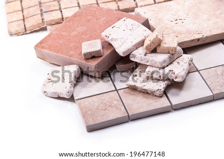 Decorative tiles, marble and stone on white background - stock photo