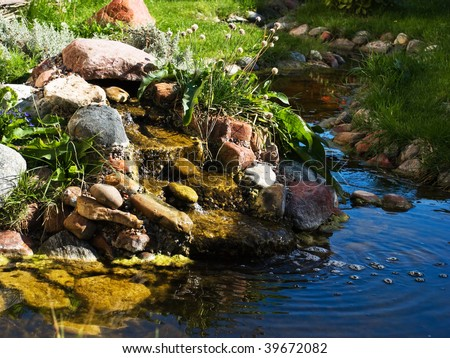 Decorative waterfall with a pond