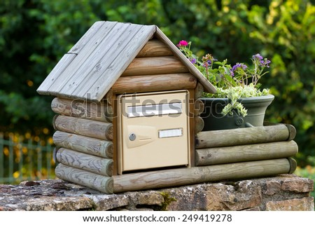 Decorative wooden post box in France - stock photo
