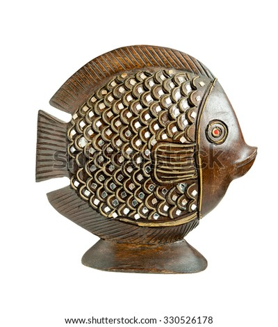 Decorative wooden sculpture of a fish with pieces of mirror glued insulation, against white background. - stock photo