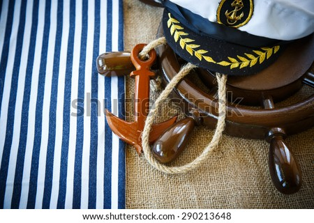 Decorative wooden ship anchored at the helm on the table
