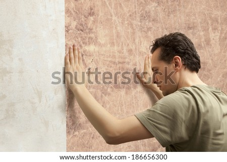 Decorator hanging wallpaper.  Repair and home concept - stock photo