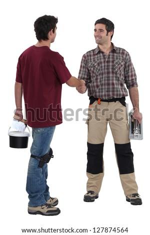 Decorators shaking hands - stock photo