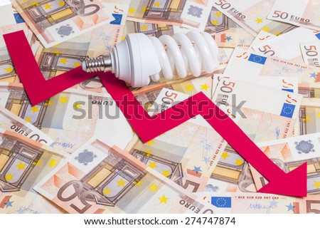 Decrease of electricity price concept. Bulb with arrow pointing down over fifty euro notes background - stock photo