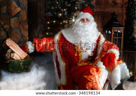 Ded Moroz (Father Frost) - traditional Christmas character sitting on the porch