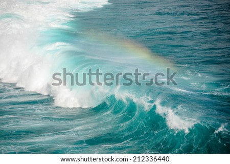 Deep azure wave makes rainbow - stock photo
