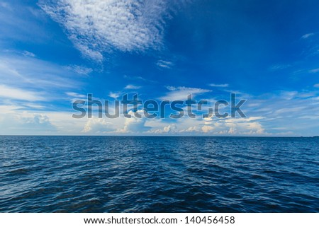 deep blue ocean and blue sky in andaman sea, thailand - stock photo