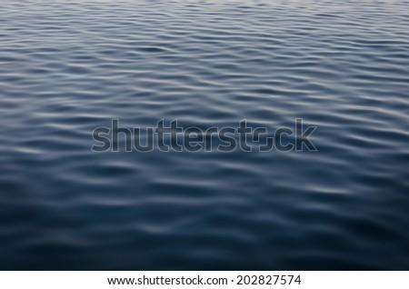 Deep blue sea texture background. - stock photo