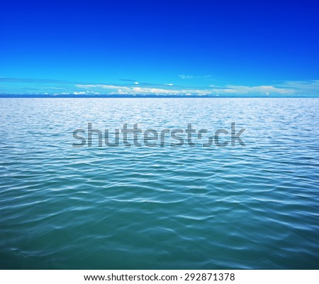Deep blue sea waters and clear sky