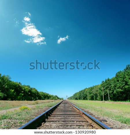 deep blue sky over old railroad - stock photo