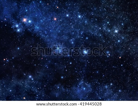 Deep blue space background filled with nebulae and shining stars