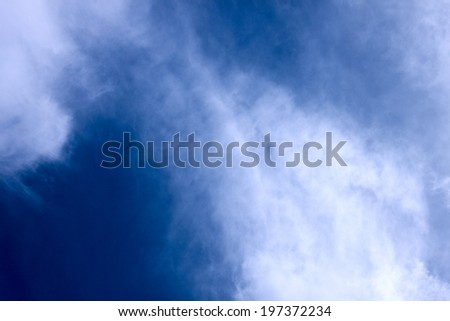 Deep blue summer sky with spindrift  clouds - stock photo