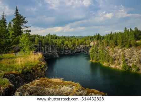 deep cold lake in the Karelia - stock photo