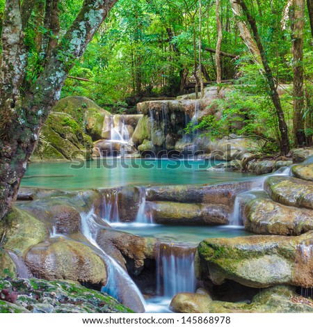 Deep forest Erawan Waterfall, Kanchanaburi, Thailand  - stock photo