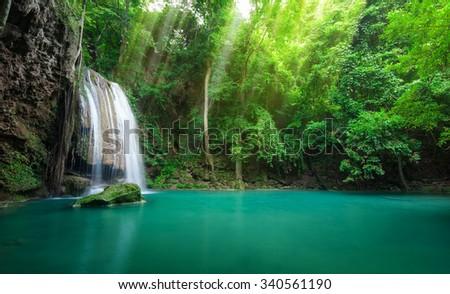 Deep forest waterfall at Erawan waterfall National Park Kanchanaburi Thailand - stock photo