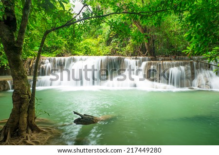 Deep forest waterfall at Huay Mae Kamin waterfall National Park Kanjanaburi Thailand