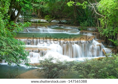 Deep forest waterfall at Mae Khamin waterfall National Park Kanjanaburi Thailand
