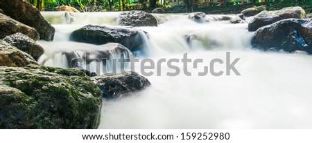 Deep forest waterfall at Nang Rong Waterfall in Nakornnayok, Thailand - stock photo