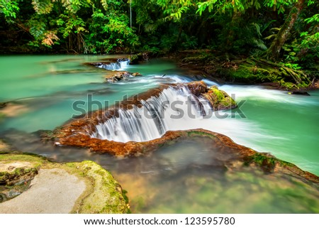Deep forest Waterfall HDR - stock photo