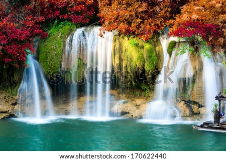 Deep forest waterfall in autumn - stock photo