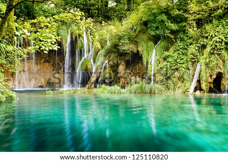 Deep forest Waterfall in Plitvice Lakes National Park, Croatia - stock photo