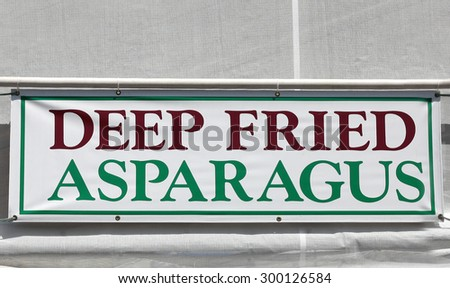 Deep Fried Asparagus Sign at the Festival - stock photo