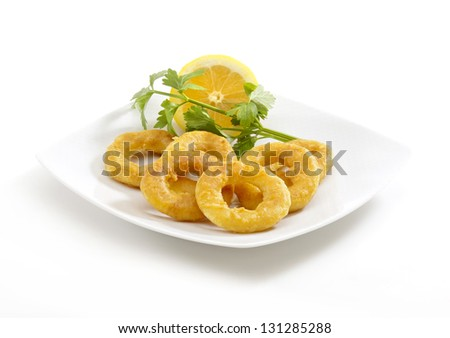 deep fried breaded calamari rings in a white background - stock photo