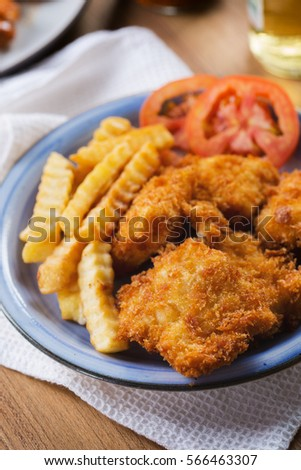 deep fried breaded dory fish with chip