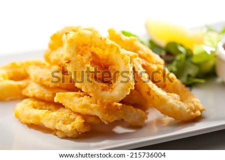 Deep Fried Calamari Rings. Selective Focus - stock photo