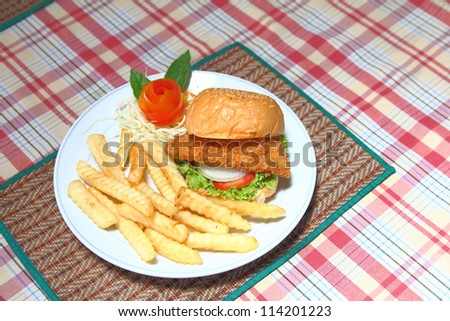 Deep fried chicken burger on white plate