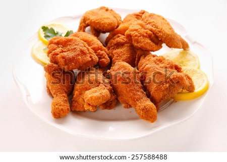 Deep fried chicken wings on a white plate - stock photo