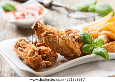 deep fried chicken with french fries and sauce
