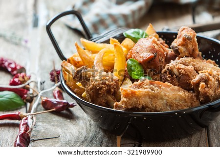 deep fried chicken with french fries and sauce - stock photo