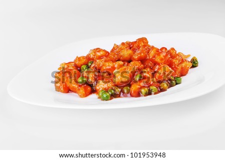 deep fried chicken with red sauce. chinese cuisine