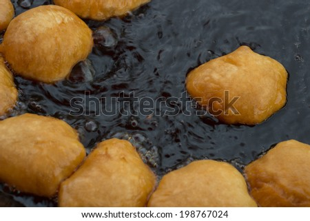 Deep-fried dough stick on the pan. - stock photo