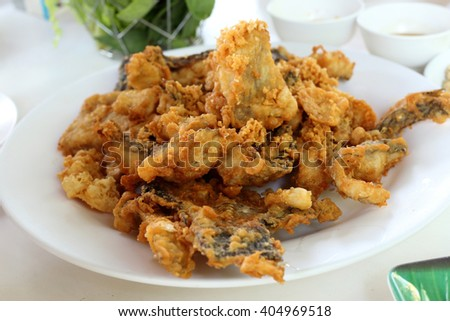 Deep fried fish served with vegetable. - stock photo