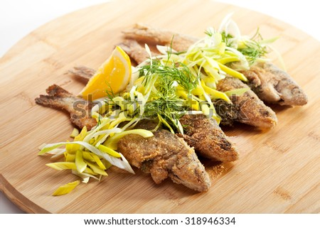 Deep Fried Fish with Lemon and Parsley - stock photo